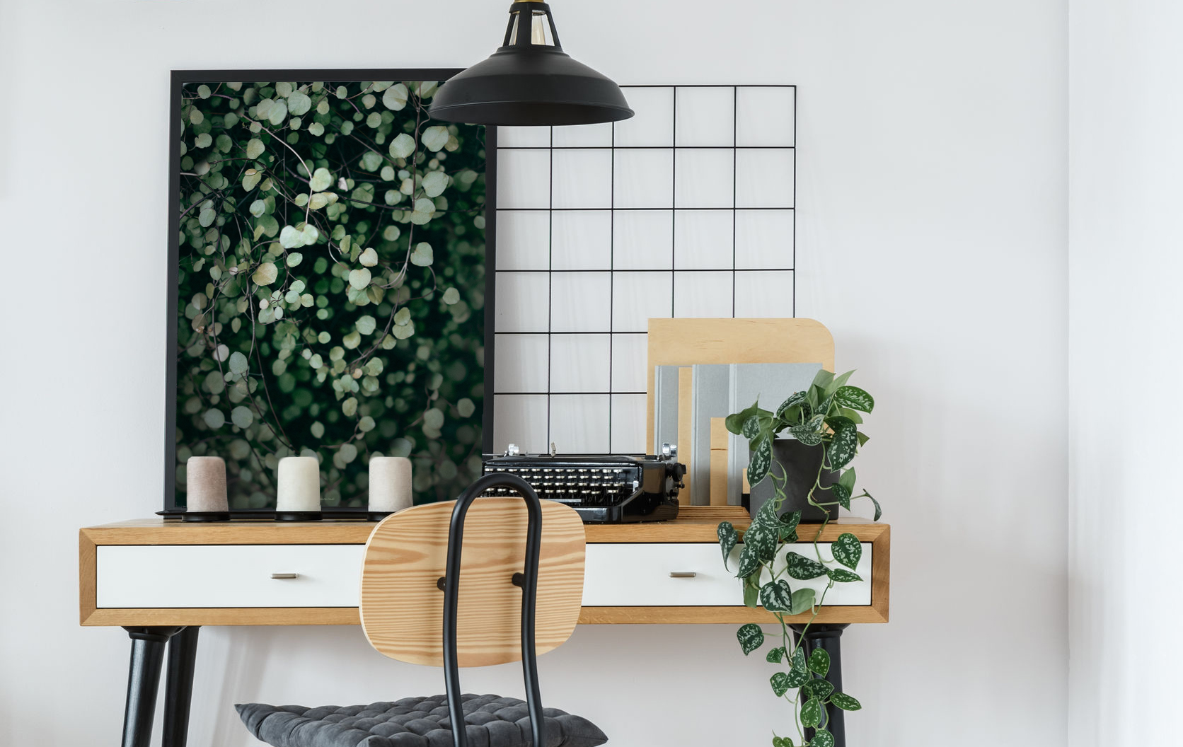 93191281 - modern retro style desk and chair in cozy white home office interior with vintage typewriter, plant and poster